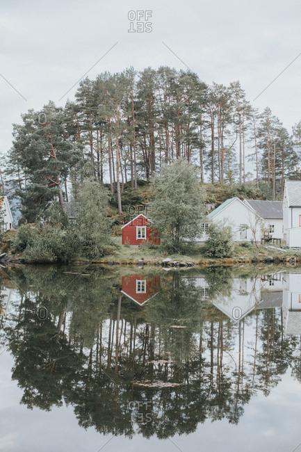 Buildings nestled on rural shore