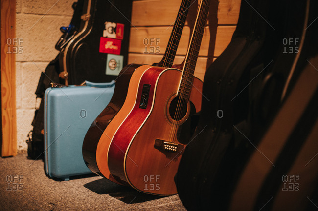 Guitars and cases by wall