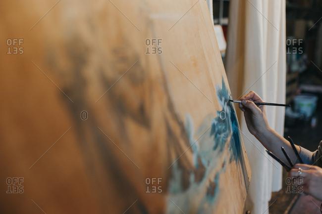 Person painting a landscape