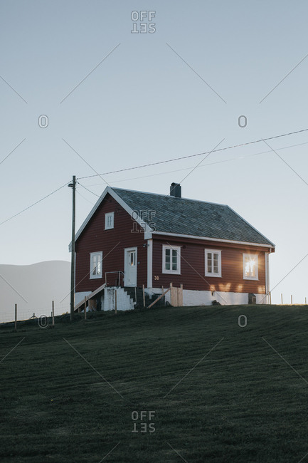 Small wooden house in rural setting