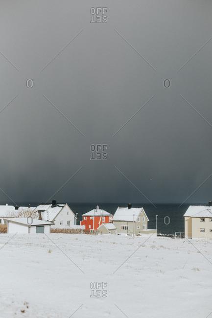 Houses along a snowy shore