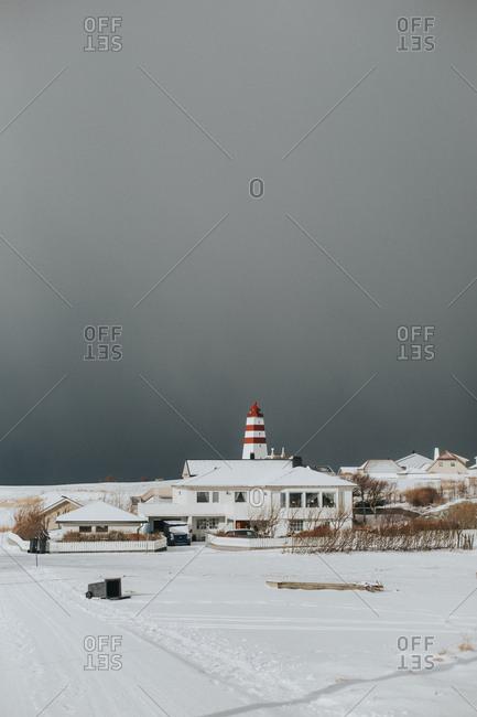 Buildings along a snowy shore