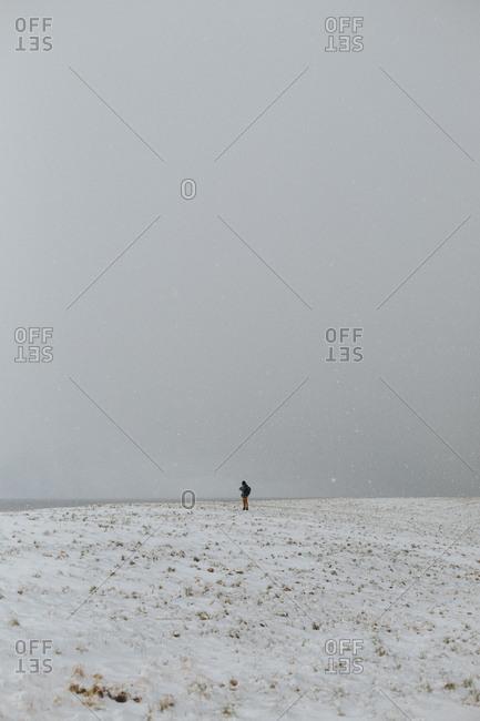 Person alone in snowy field
