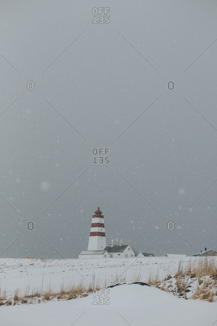 A lighthouse in the snow