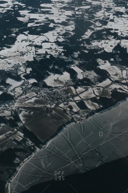 Rural plots in snowy coastal area