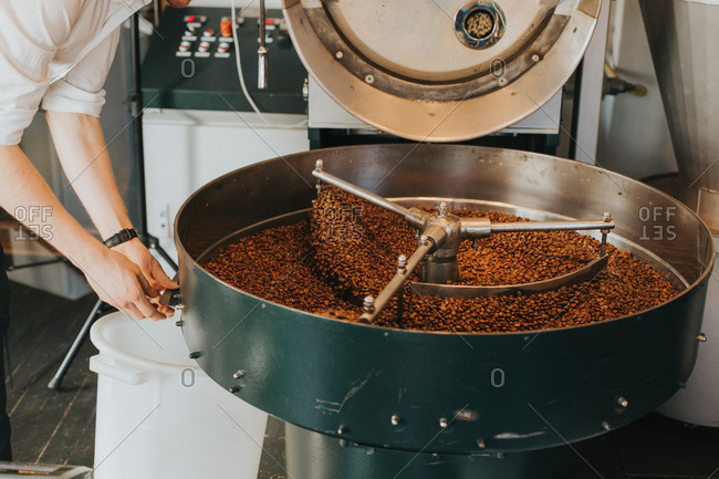 Man at industrial coffee roaster