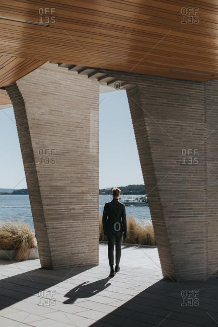Man in suit on modern terrace