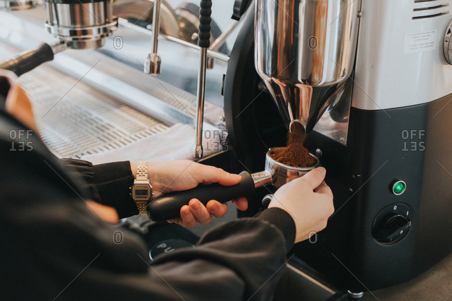 A barista grinding coffee