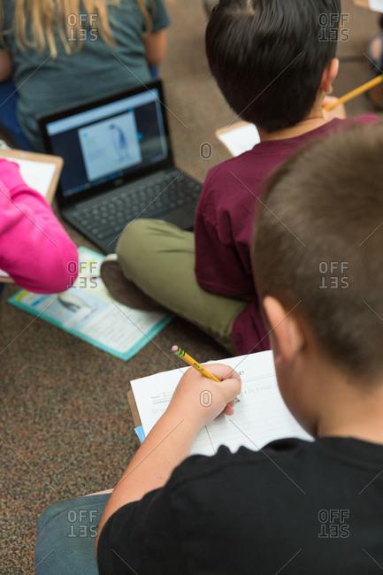 Children using laptop computer in classroom.