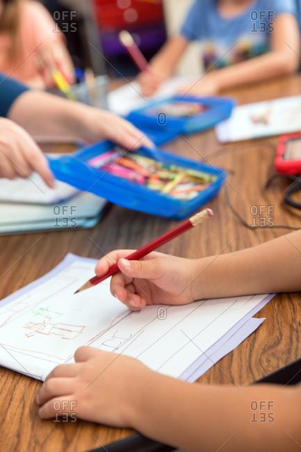 Kindergarten student writing in class.