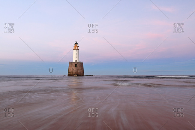 A colorful Sunset at Rattray Head Lighthouse on the north east coast of Scotland.