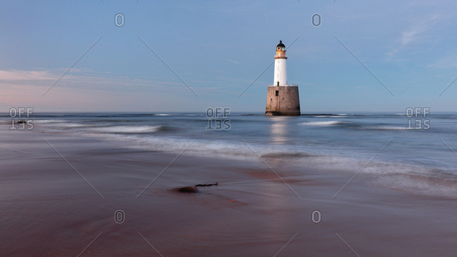 Rattray Head Lighthouse during evening twilight.