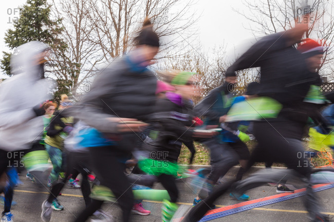 Blurred runners in street race