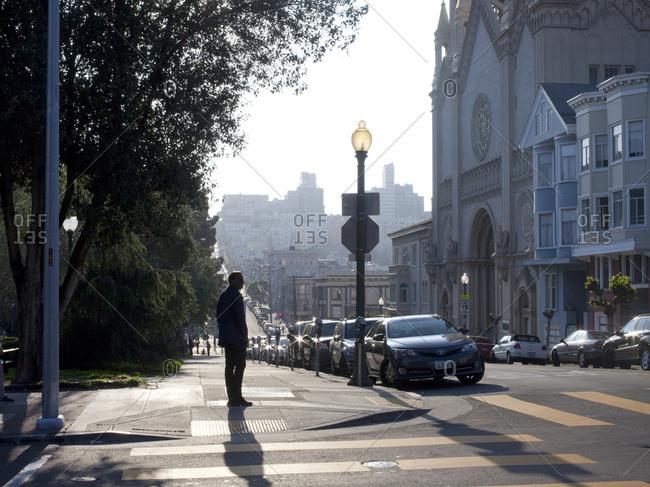 October 8, 2015 - San Francisco, California: Man standing on street corner in North Beach neighborhood