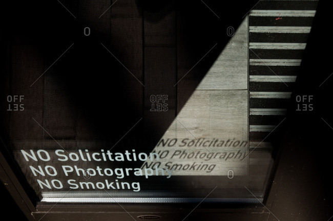 Sign on window casting shadow on floor