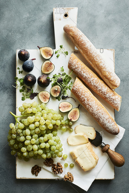 Fruit and cheese board with fresh figs, grapes and Italian Taleggio cheese