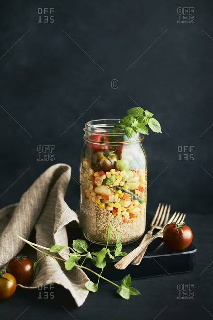 Jar filled with Summer succotash and quinoa
