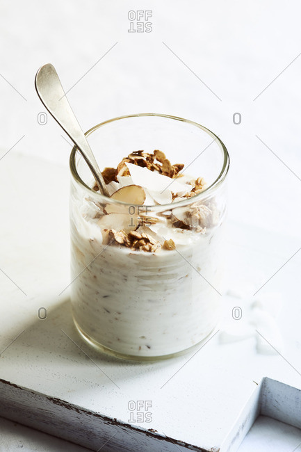 Overnight oats topped with granola, almonds and coconut