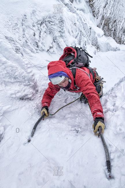 Scotland- Anoach Mor- Man ice climbing in winter