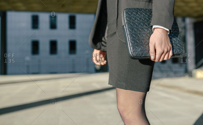 Businesswoman carrying briefcase- mid section