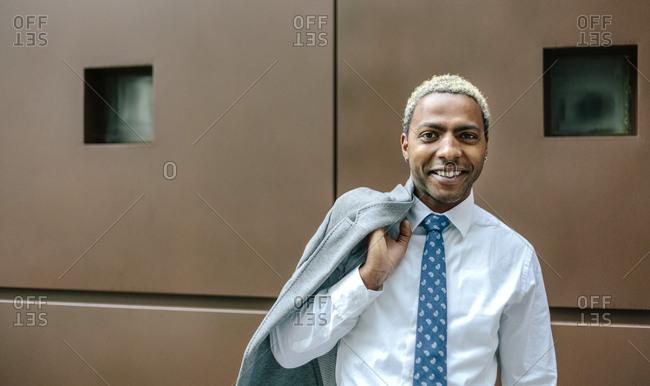 Black businessman with blond hair- portrait