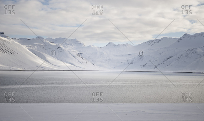 Iceland- water and snow-covered mountains