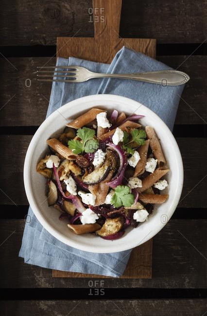 Spelt rigatoni with aubergines- feta and raisins