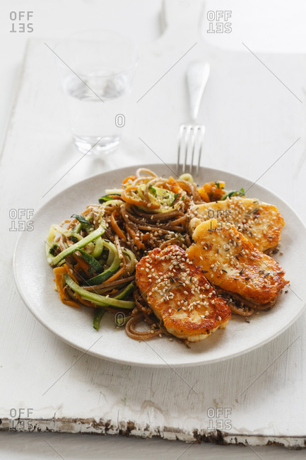 Spelt whole grain spaghetti with zoodles- carrot slices and fried Halloumi