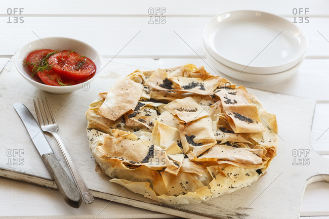 Vegetable pie made of filo dough with kale- chard and poppy seed