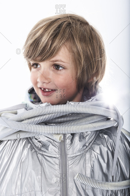 Portrait of a smiling boy wearing fancy dress with tube wrapped around his neck