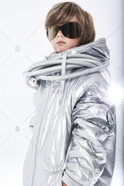 Portrait of a cool boy wearing sunglasses and fancy dress
