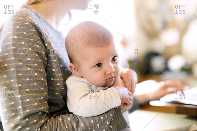 Mother holding baby at home