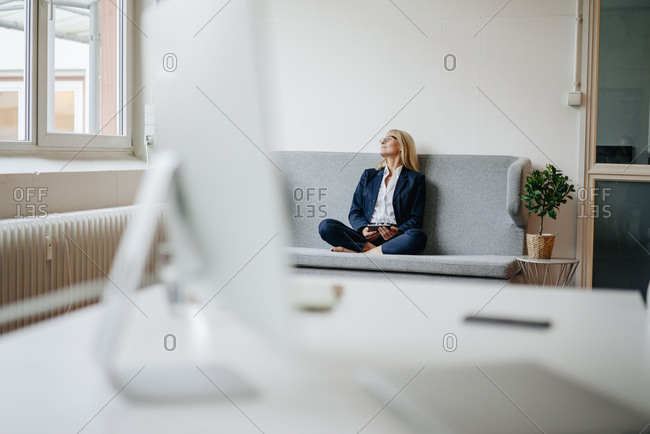 Relaxed businesswoman sitting on couch