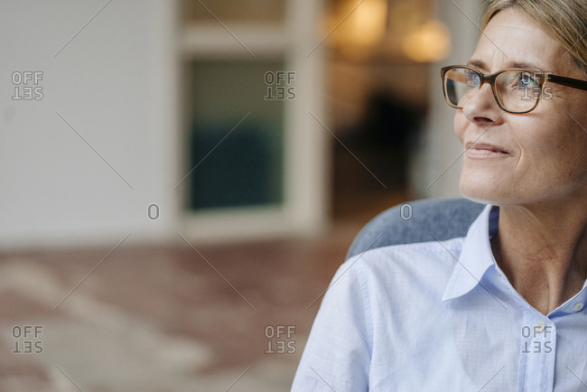 Businesswoman wearing glasses looking away