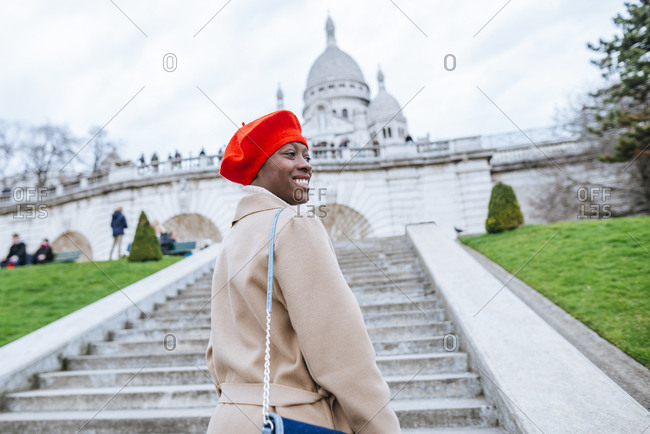 Young woman in Paris standing in front of Sacre Coeur church