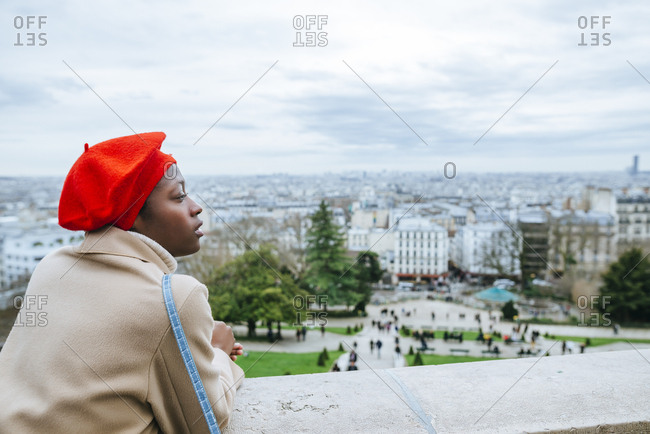 Young woman in Paris looking over the city