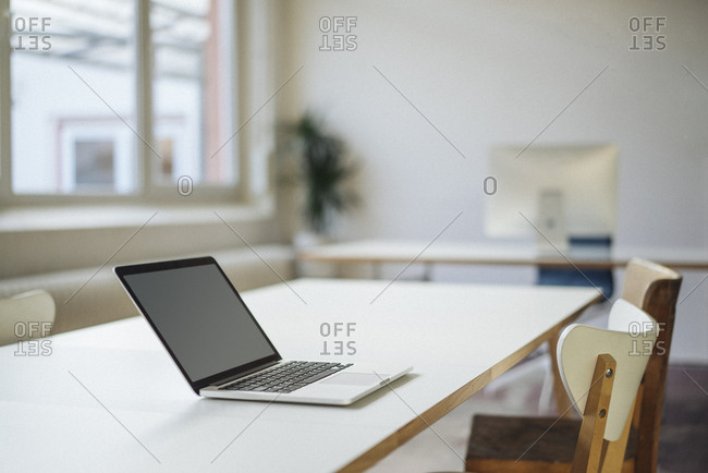 Laptop on table in office