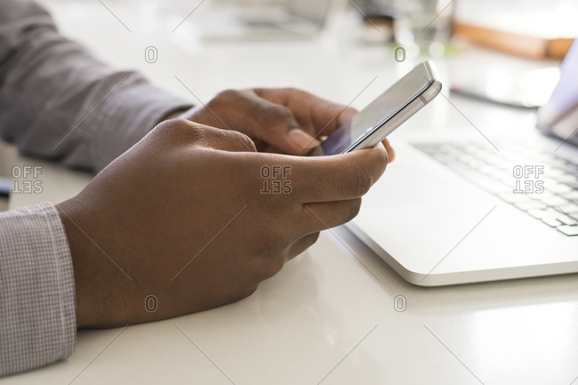 Close-up of businessman using smartphone