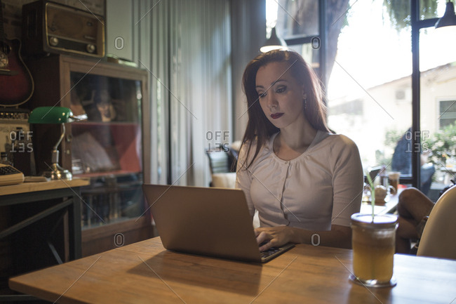 Woman using a laptop in a cafe