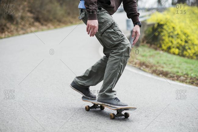 Man skating down the road
