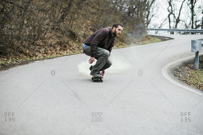Man skating down the road