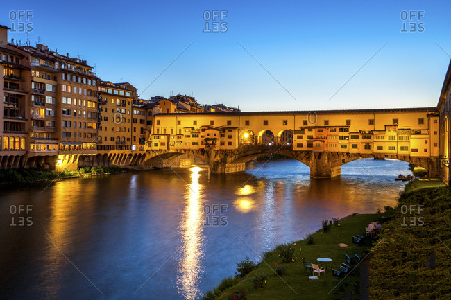 Italy- Tuscany- Florence- view to Arno River and lighted Ponte Vecchio at blue hour