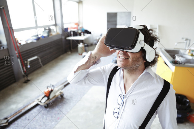 Architect wearing Virtual Reality Glasses at construction site