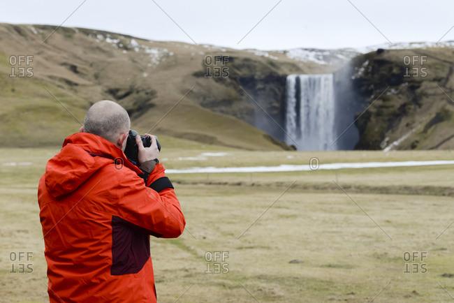 Iceland- photographer at Skogafoss waterfall