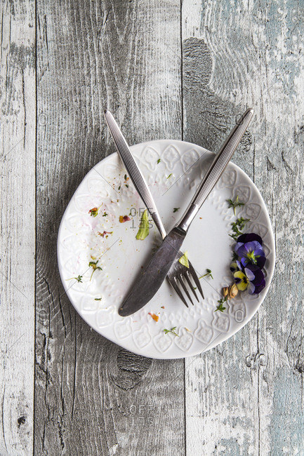Plate with cutlery and remains of dish