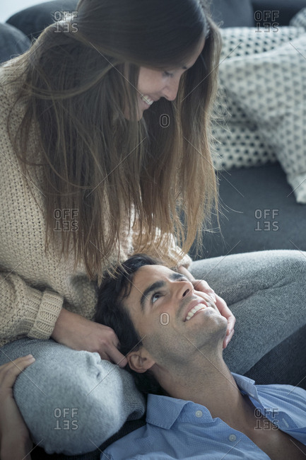 Smiling young couple in love at home