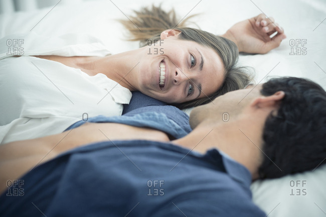 Smiling young couple in love lying down