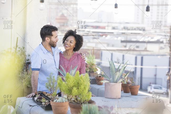 Couple standing in their rooftop garden