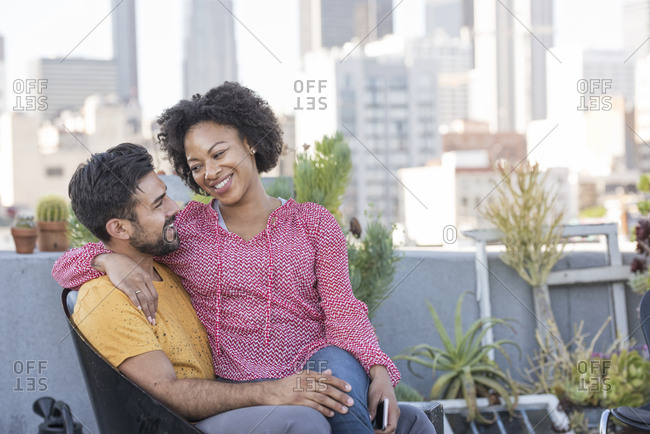 Couple sitting on rooftop terrace