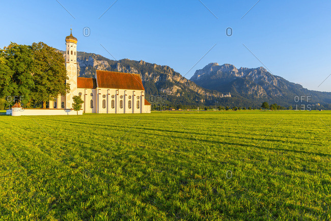Germany- Schwangau- pilgrimage church St. Coloman- Neuschwanstein Castle and mountain Saeuling in background